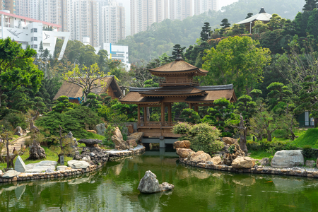 The Golden pavilion and gold bridge in Nan Lian Garden near Chi Lin Nunnery. A public chinese classical park in Diamond Hill, Kowloon in Hong Kong city