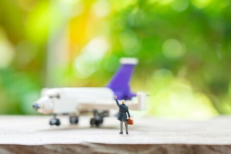 Miniature people businessmen standing with Plane model as background strategy concept and Business concept with copy space and white space.
