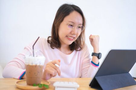 Asian businesswoman Congratulated and glad Success through working with a tablet, business concepts and working outside the office Stock fotó
