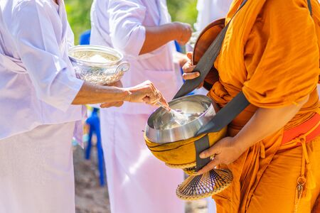 The monks of the Buddhist Sangha(give alms to a Buddhist monk), which came out of the Buddhist offerings in the morning. In order to demonstrate faith faithfully perform the duties recently. Zdjęcie Seryjne