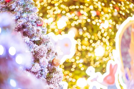 Decorated Christmas tree with fir tree on bakeh background. Merry Christmas and New Year holidays background with copy space for your text