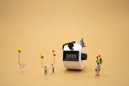 Family Miniature people standing with 2020 Happy new year using as background Universal day concept and Happy new year concept with copy space  for your text or design. Zdjęcie Seryjne
