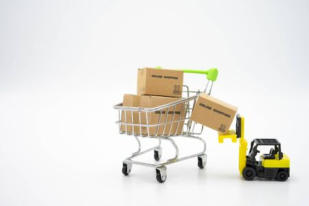 Online shopping with a shopping cart and shopping bags delivery service using as background shopping concept and delivery service concept with copy space  for your text or  design.
