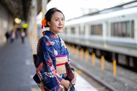 Geishas girl wearing Japanese kimono among in Kyoto, Kimono is a Japanese traditional garment. The word