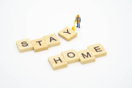 Stay Home. Miniature people stay apart to reduce Covid 19 virus infection. Maintain social distance Detained, could not find anyone. using as background Healthcare concept and keep distance.