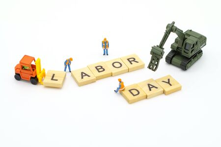 Miniature people standing with wood word Labor Day using as background Universal day concept and Health Day concept with copy space  for your text or design. Banque d'images