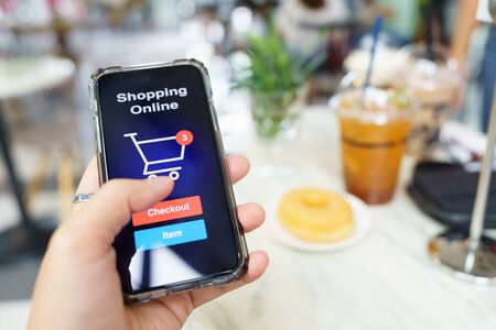 Online shopping with smartphone and shopping bags delivery service using as background shopping concept and delivery service concept with copy space  for your text or  design. Banque d'images