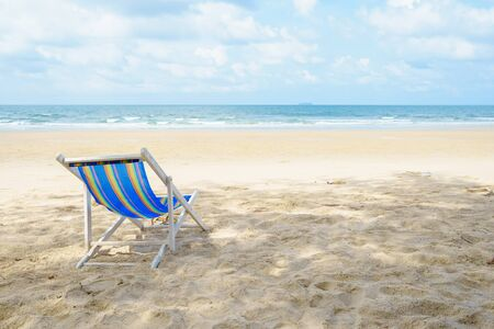 chairs on the beach near the sea. enjoying looking view of sea with blue sky on summer vacation and travel holiday concept. Banque d'images