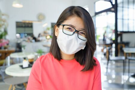 New normal asian beauty Wear a mask to prevent Covid 19 viruses or coronavirus. Scaffolding with Smiling under the mask. Social distancing and and keep distance concept. Banque d'images
