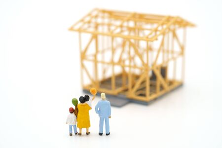 Miniature people standing Check the quality in the home. Concept of buying a new home .Home inspection for maintenance Repair and Construction with copy space for your text or design.