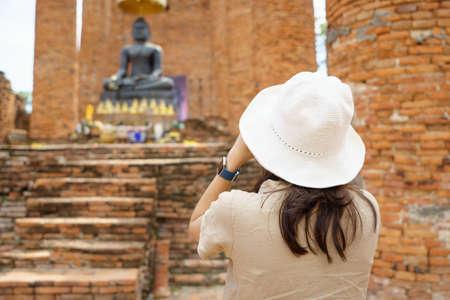 Beautiful Asian tourists Walking, taking photos and traveling on holidays The old town, world city Ayutthaya kingdom Phra Nakhon Si Ayutthaya, Thailand