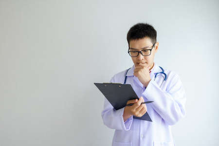Portrait of Male asian doctor in a uniform working in the office hospital. healtcare and assistance concept