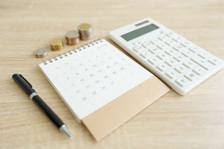 Home calculators, and pens. Investing in investment in real estate Home loan using as background business concept and real estate concept with copy space for your text