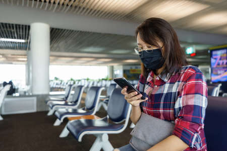 woman wearing face mask is traveling on The airport , New lifestyle travel after covid-19. Social distancing and Travel bubble concept. Stock fotó