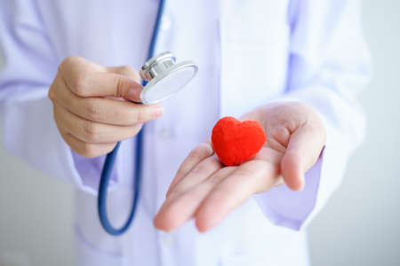 Heart check Doctor holding Red heart on hands at hospital office.Healthcare And Medical concept. Stock fotó