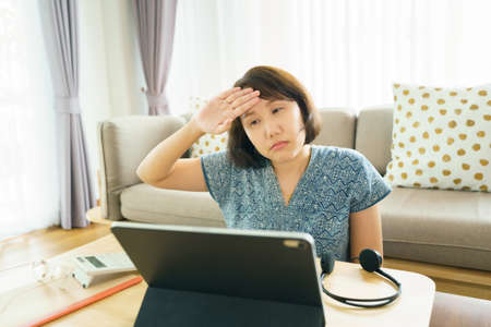 Asian woman aged 30-35 years using tablet, watching lesson Sign language online course communicate by conference video call from home, e-learning education concept