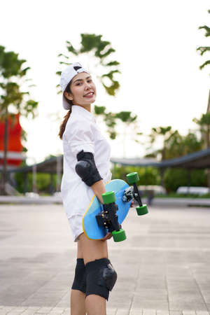 Hello Summer Surfers people Asian having fun with surfboards or surf skate around city streets background on a summer day. Free relax lifestyle and millennial trend concept