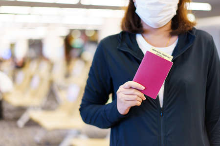 Passport with vaccination certificate for COVID-19 person record card. Immune passport or certificate for Get vaccinated before travel. Vaccination, disease immunity passport 免版税图像