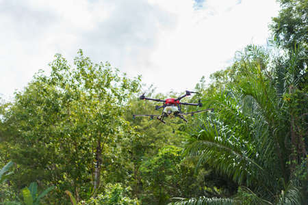 agricultural drone Fly for fertilizers and pesticides. modern agriculture new agricultural innovation automatic drone