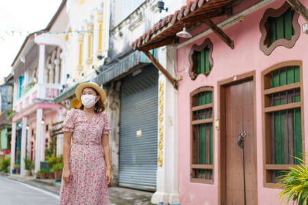Travelers on street Phuket old town with Building Sino Portuguese architecture at Phuket Old Town area Phuket, Thailand. Travel concept