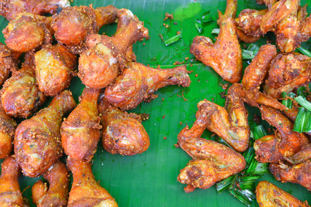 Fried chicken with black pepper paste on banana leaf.