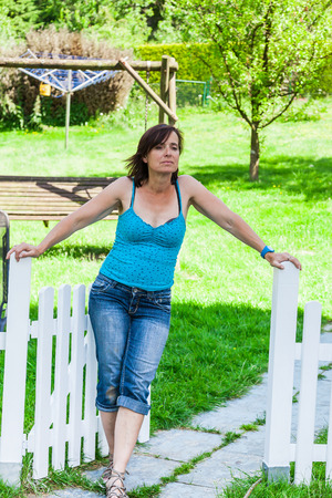 picket fence: Woman at a picket fence Stock Photo