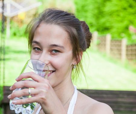 gulp: Teenage girl drinking a glass of water