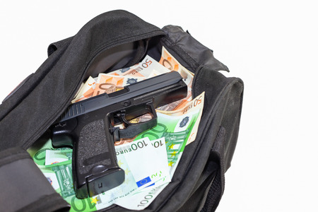 extortion: Loot from bank robbery - Sports bag full of money with gun-cutout