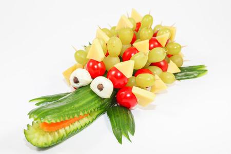Cucumber crocodile - crocodile carved out of a cucumber Standard-Bild