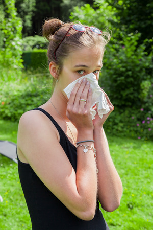 handkerchief: Teenage girl with hay fever and handkerchief