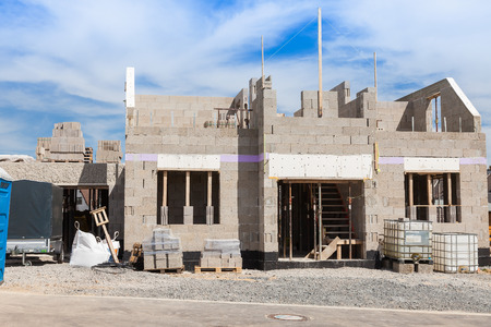 homeowners insurance: Shell of a house on a construction site Stock Photo