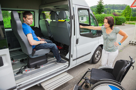 Handicapped boy is picked up by school bus