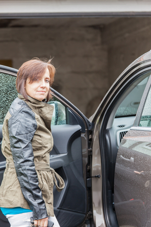 gets: Woman gets into a car