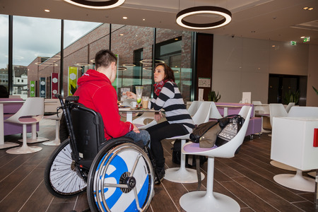 Mother with handicapped son in an ice cream parlor Standard-Bild