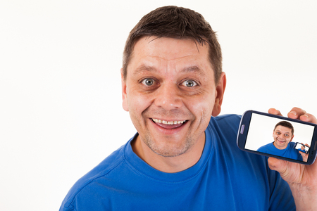 photo backgrounds: A man with repetitive self-portrait on his mobile phone. Stock Photo