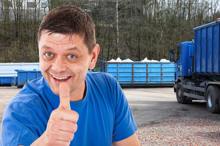 forwarding agency: Man with thumbs up in front of a recycling-forwarding