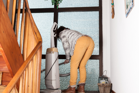 sucks: Wife sucks with an old vacuum cleaner in an old staircase.