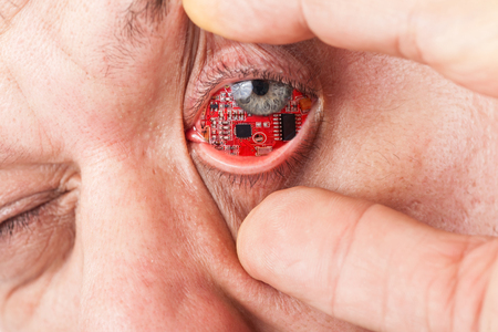 Man with a circuit board in his eye