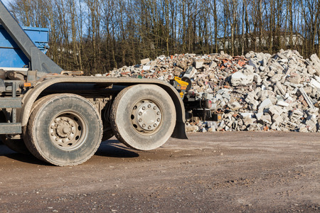 detritus: Recycling trucks with rubble in the background