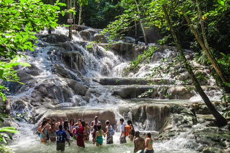 Ocho Rios, Jamaica - November 15, 2016: The Dunn's River Falls are waterfalls in Ocho Rios in Jamaica, which can be climbed by tourists. Editorial