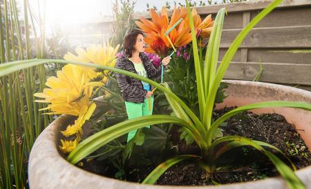Woman in an oversized flower head