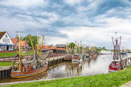Greetsiel, Germany - May 14, 2017: The fishing port of Greetsiel. Greetsiel is one of the most beautiful fishing villages on the German North Sea.