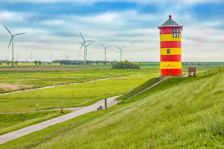 The Pilsum lighthouse on the North Sea coast of Stock Photo