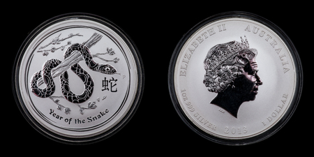 Front and back of an Australian silver coin. 1 dollar Lunar 2 year of the snake 1oz 999 silver Editorial