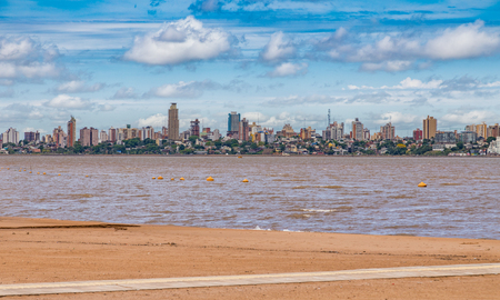 Skyline of Posadas in Argentina, photographed from the beach in Encarnacion / Paraguay. Stock Photo