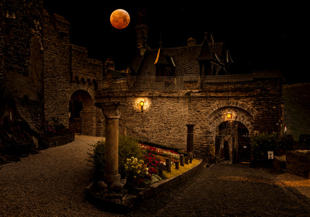 Blood moon over medieval city