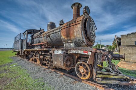 Encarnacion, Paraguay - November 14, 2018: Old rusted steam locomotive at Encarnacion. In Paraguay there is no more rail traffic today.