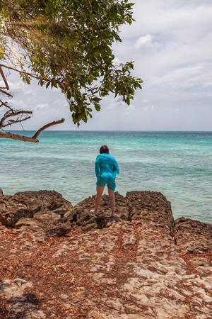 Young woman at Eagle Beach in Aruba.