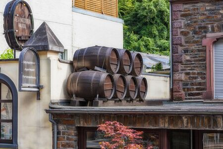 Cochem, Germany - August 02, 2014: Wine barrels on the canopy of a hotel and bar in the city of Cochem at the Mosel in Germany.
