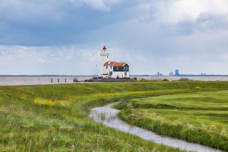 The lighthouse of Marken, a small island in the Markermeer in the Netherlands on a stormy day. Stock Photo